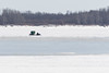 Snowmobile taxi heading across the frozen Moose River from Moose Factory Island to Moosonee 2017 April 17th.