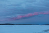 Line of purple clouds up the Moose River before sunrise.