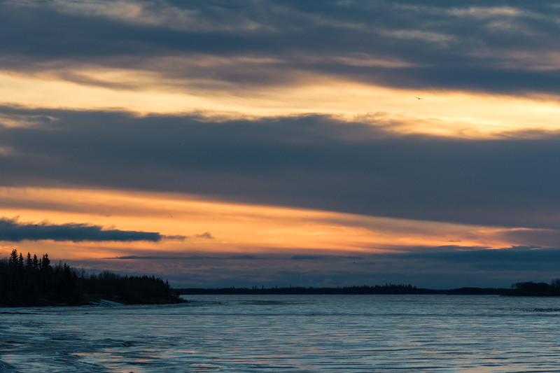 Sunrise at Moosonee 2017 April 28th. Looking down the river. Ice intact.