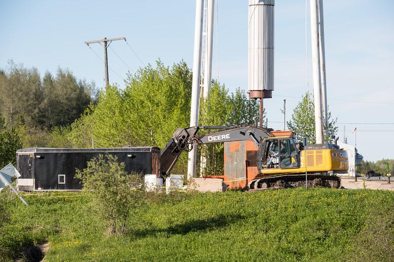 Preparing to demolish the water tower.