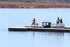 Child on bicycle on dock in Moosonee.