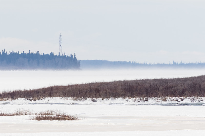 Looking up the Moose River with light blowing snow.