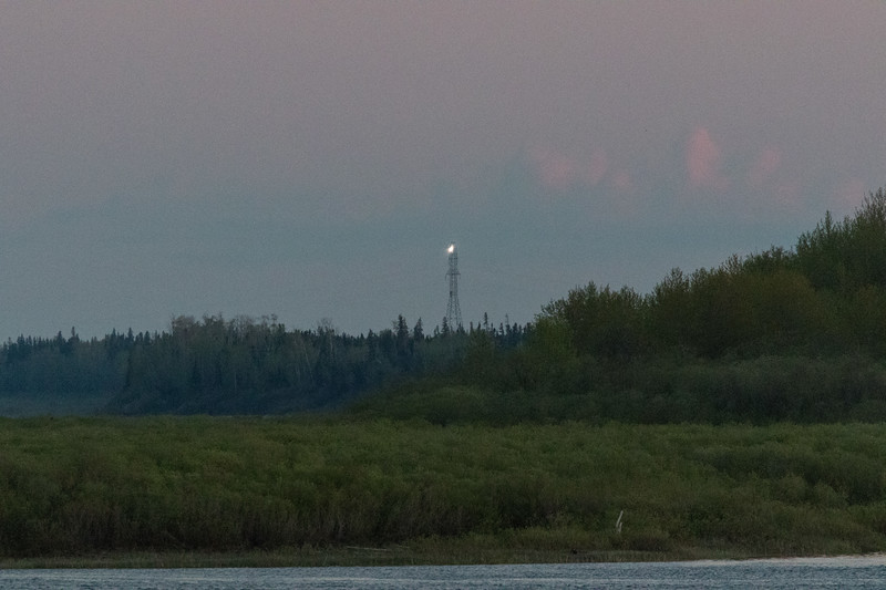 Lights running up and down hydro tower up the Moose River.