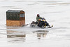 Snowmobile taxi on the Moose River 2017 December 5th. Some water on the ice.