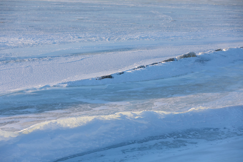Clear ice along the tidemark of the Moose River.