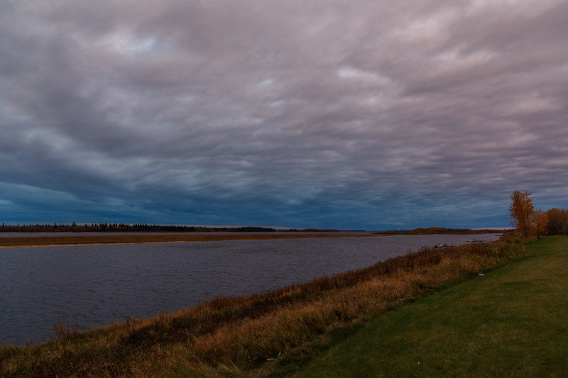 Cloudy skies before sunrise. Looking up the Moose River from Moosonee.