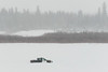 Ontario Provincial Police OPP vehicle on the Moose River headed to Moose Factory from Moosonee.