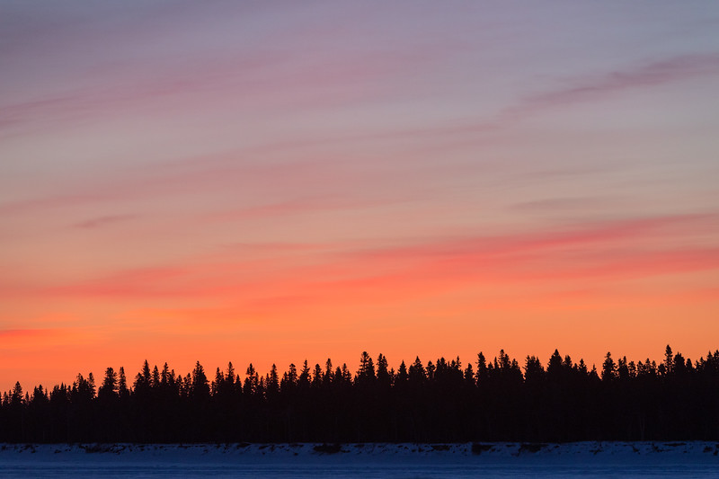 Sky before sunrise across the Moose River from Moosonee. Purple and pink.