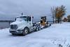 D4H bulldozer on float truck along the river.