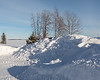 Snow piled along the river  bank in Moosonee. 2018 January 20th.