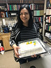 Kathryn Hookimawillene with cake for her 8th anniversary at Keewaytinok Native Legal Services.