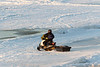 Snowmobile and sled crossing the tide mark 2018 April 26th.