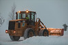 Caterpillar IT28G loader heads up Revillon Road in moderate snow 2018 January 8th.