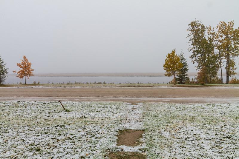 Snow falling along the Moose River in Moosonee 2018 October 6.