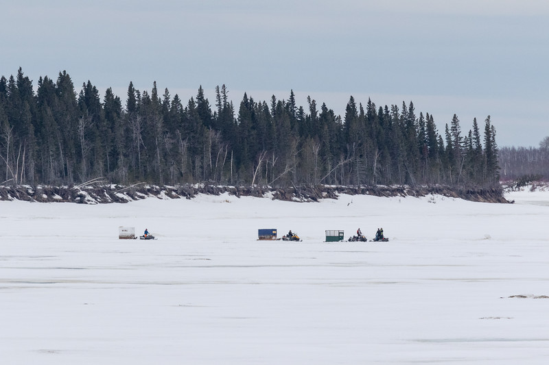 Snowmobile taxis on the Moose River at Moosonee 2018 April 24th.