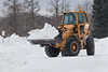 Loader moving snow on Revillon Road