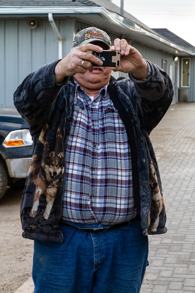 Tom Wesley taking photograph at Moosonee train station