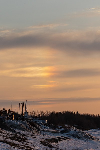 Sun dog or partial rainbow to the west of the sun down the Moose River from Moosonee.