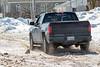 Truck driving through the slush on Revillon Road in Moosonee.