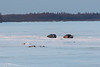 Vehicles on the Moose River shortly afte sunrise 2018 April 26th.