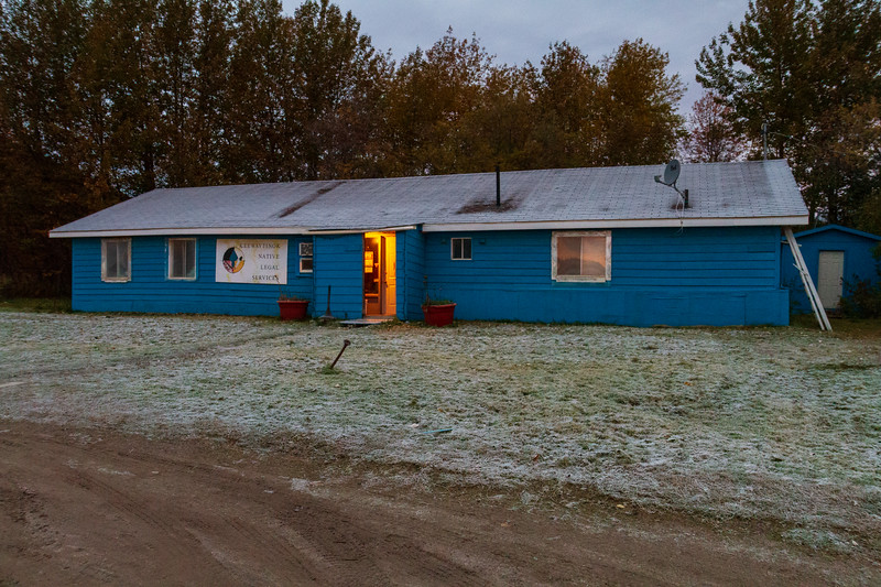 Keewaytinok Native Legal Services just before sunrise 2018 October 8. Frost on the roof and lawn.