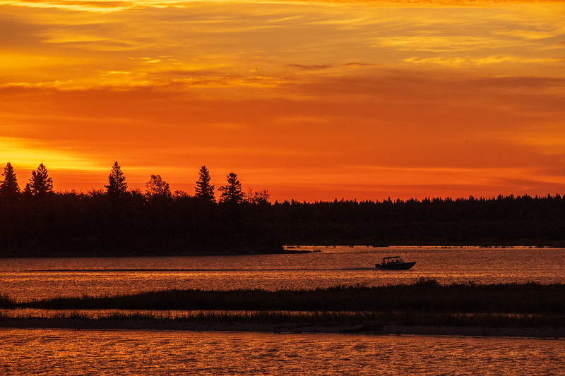 Taxi boat heads to Moose Factory from Moosonee before sunrise 2018 October 3.