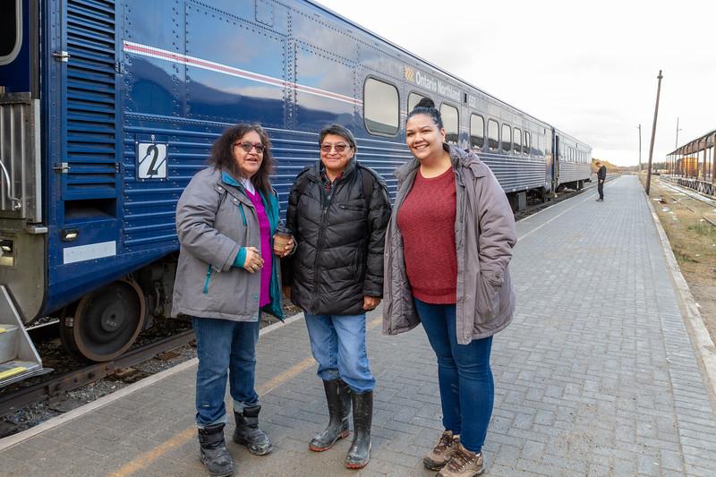 Denise Lantz, Celine Koostachin and Kathryn Hookimaw at train station in Moosonee