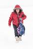 Denise Lantz walking towards front door on a snowy day.