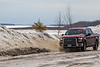 Truck coming through some water along Revillon Road in Moosonee. 2018 April 23rd.