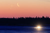 Thin moon rising across the Moose River before dawn. 2018 February 13th.