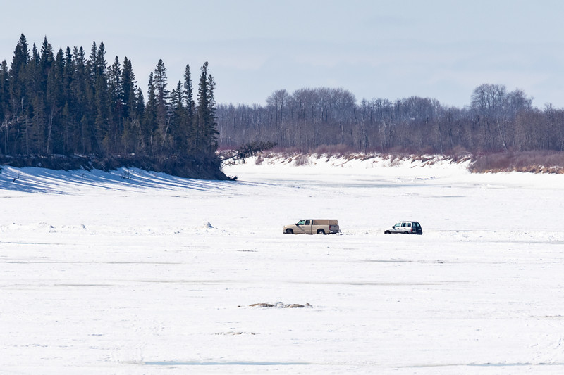 Two vehicles on the Moose River at Moosonee 2018 April 25th.
