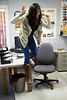 Ruchi Punjabi celebrates becoming a lawyer by jumping off a table at Keewaytinok Native Legal Services 2018 October 3.