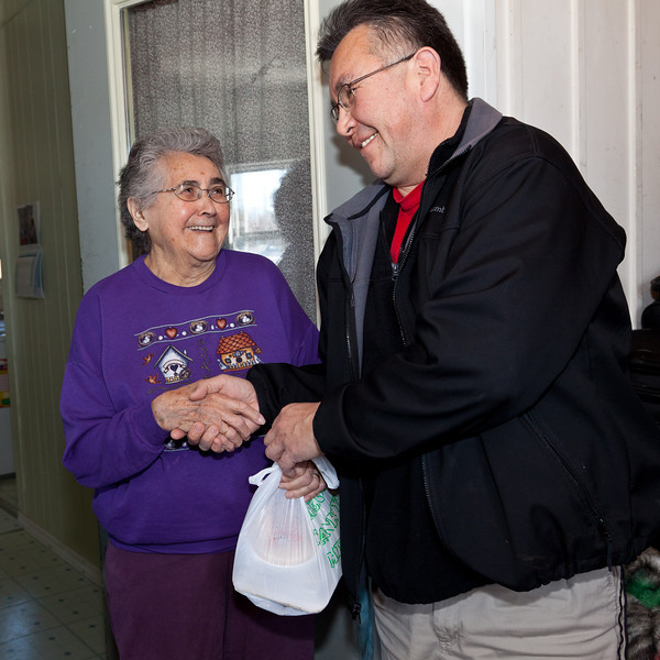 Mayor Mitchell delivers a meal to Maude Tyrer, who spent almost three decades on Moosonee's councill.