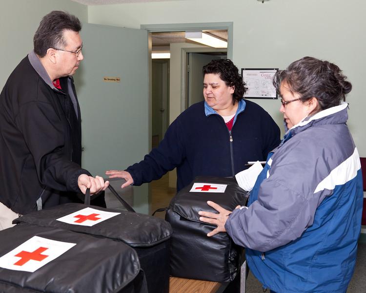 Victor, Karen and Maggie plan meal distribution