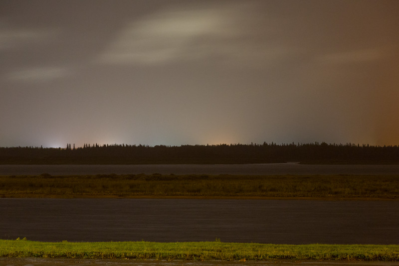 Looking across the Moose River from Moosonee in the rain. Shapes in the sky are moving clouds.