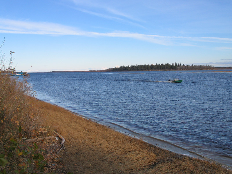 Moose River shoreline looking down to barge docks. Taxi boat. 2003 October 20