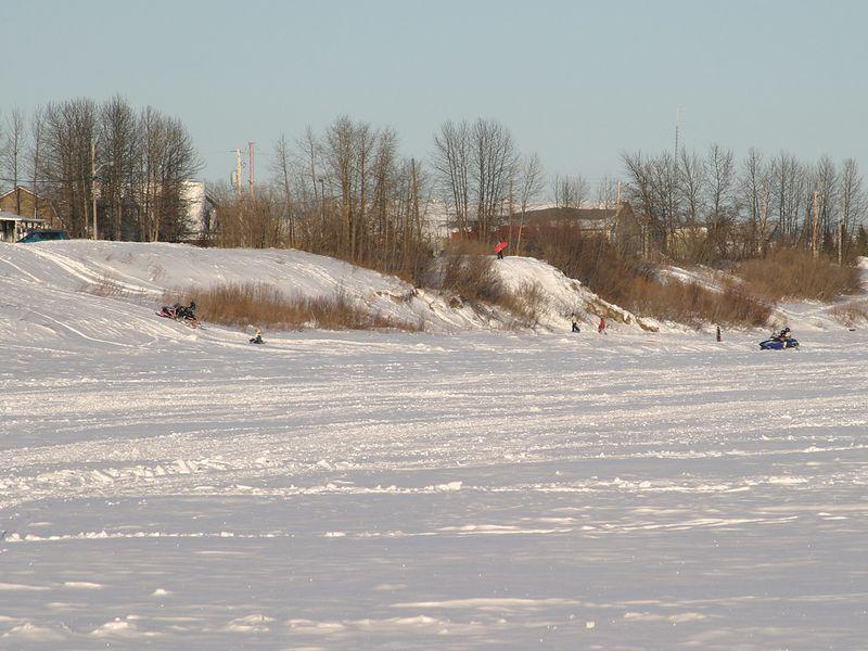 2005 January 8 children sliding down the river bank along Revillon Road in Moosonee.