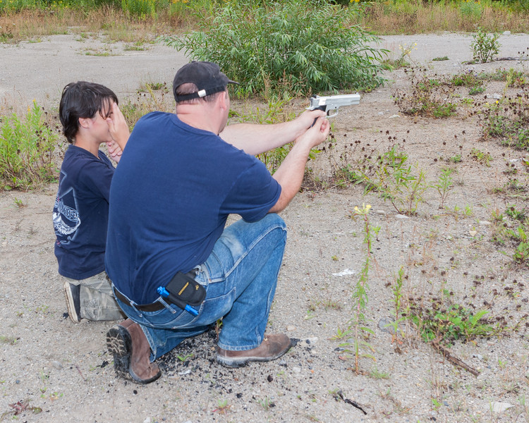 Craig Jennings showing David Hunter how to use pellet pistol at quarry 2005 August 13