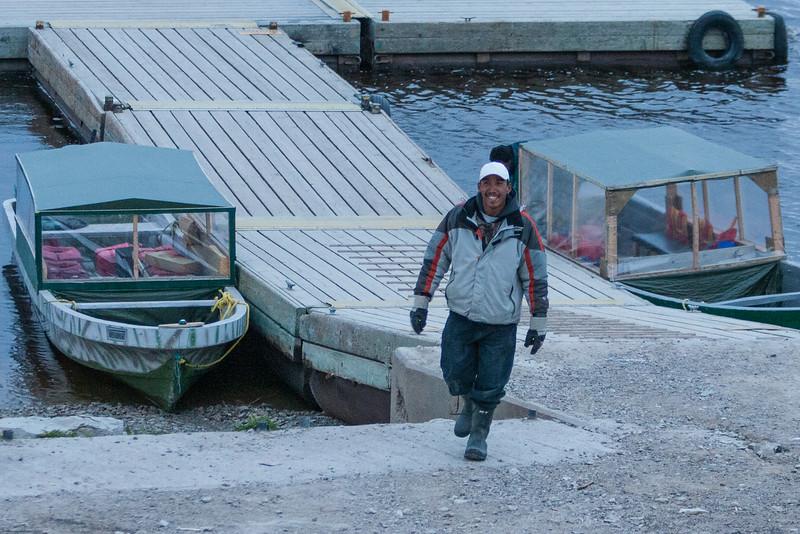 Darren Blueboy walking up from public docks in Moosonee 2005 June 8.
