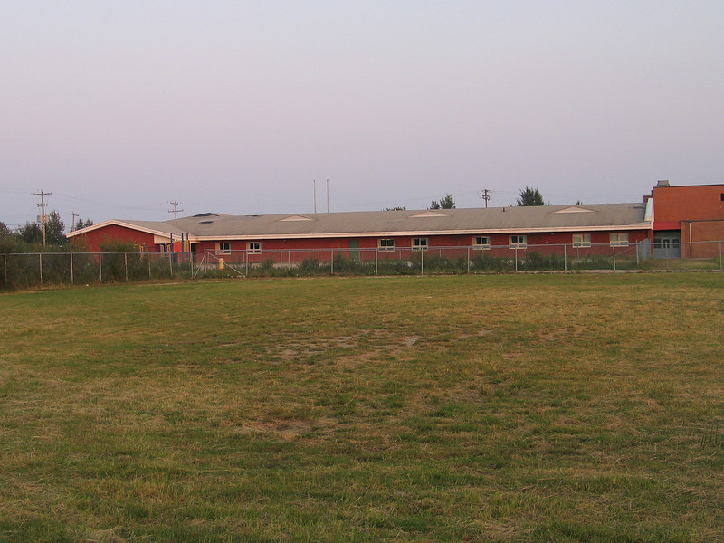 Bishop Belleau School in Moosonee, view from rear showing playground. Foreground is MPS playground. 2003 September 10