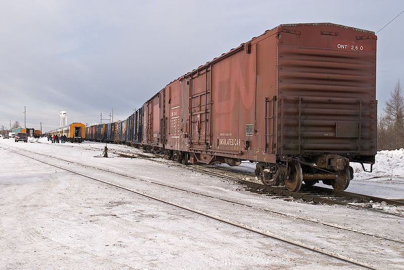 Mixed train (Little Bear) in Moosonee station. Passenger consist at left, freight section at right. Boxcar ONT 260 on 2005 March 12th.