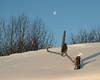 Moon over satellite TV dish at Keewaytinok Native Legal Services. 2004 December 30