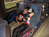 David Hunter and Colby Tozer with handheld gaming device on train. 2005 September 3