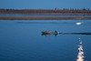 Three men in a canoe late evening on the Moose River. Reflection of moon on the water. Fishing equipment. 2005 May 22