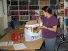 Mary Blueboy packing up dishes in the library at Keewaytinok Native Legal Services 2003 November 19th.