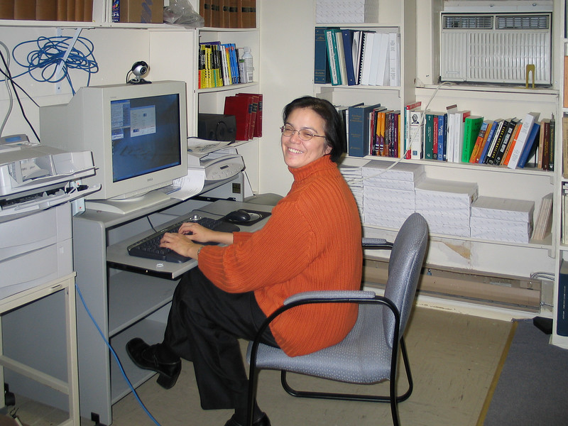 Nancy Cooper using computer in library at Keewaytinok Native Legal Services 2003 November 5