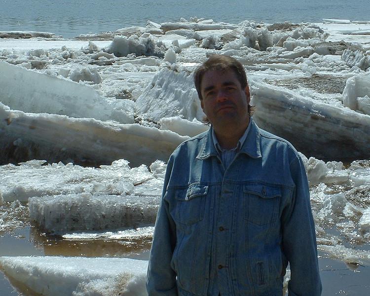 Paul Lantz in front of breakup ice in Moosonee 2003 May 6. Photo by Loretta Loon