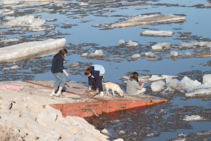 Girls watching breakup ice move past. 2005 April 18