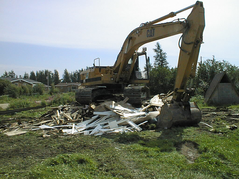 Demolition of Keewaytinok Native Legal Services staff house 2002 August 13.