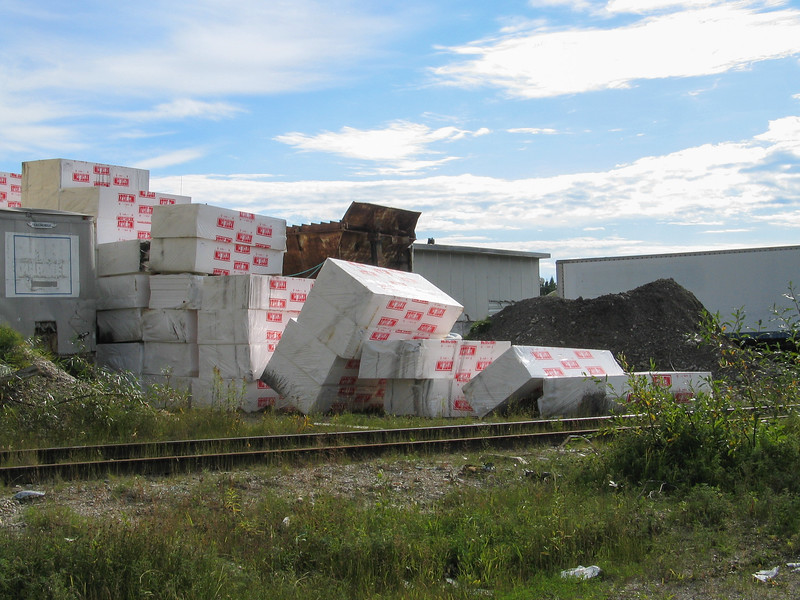 Insulation piled up at former base in Moosonee. 2004 September 19